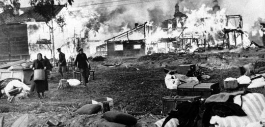 Russian men and women rescue their humble belongings from their burning homes, said to have been set on fire by the Russians, in a Leningrad suburb on Oct. 21, 1941. (AP Photo)